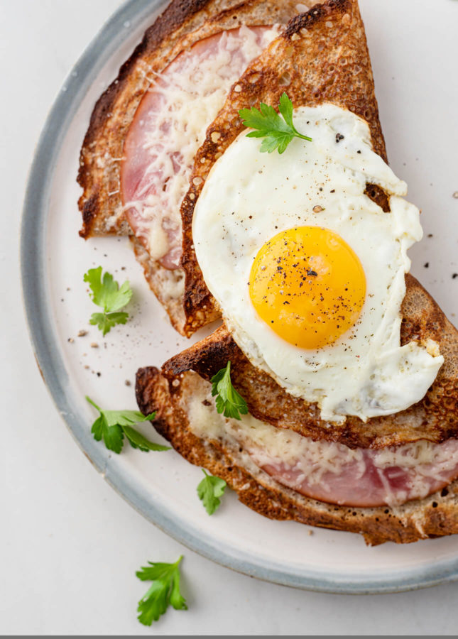 Savory buckwheat crepes filled with ham and cheese and topped with a fried egg // FoodNouveau.com