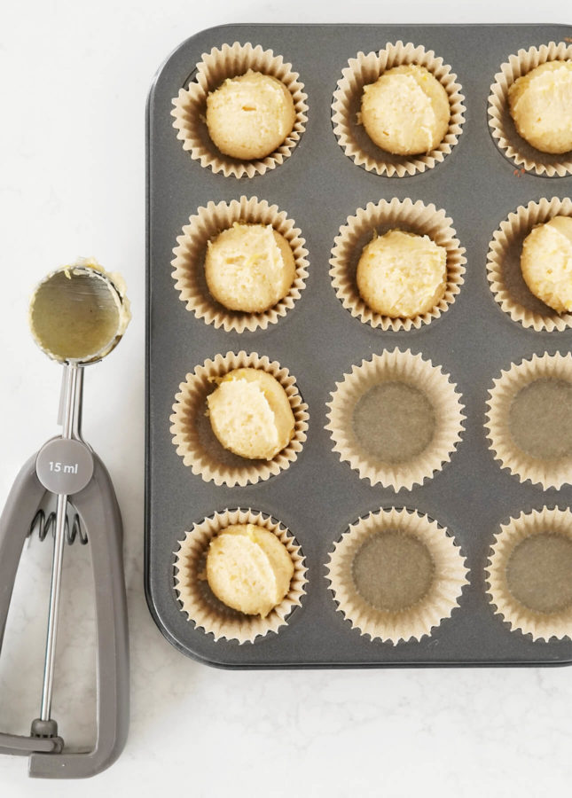 How to portion financier batter quickly and easily: with a cookie scoop! // FoodNouveau.com